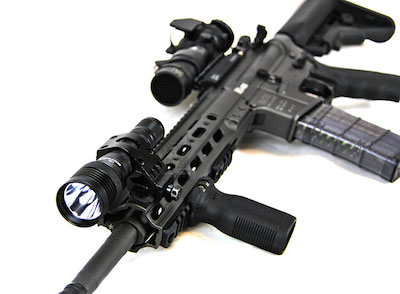 A weapon-mounted tactical flashlight